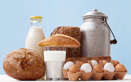 food staple: Fresh eggs, bread  and dairy products in glass and Aluminum containers