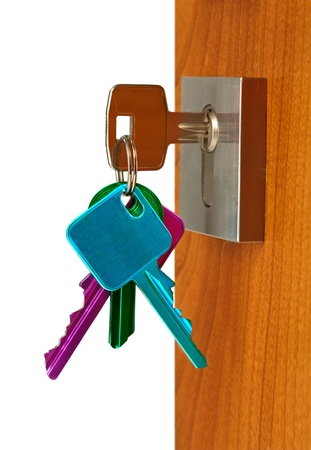 Door open with keys color in lock , isolated Stock Photo - 9830592