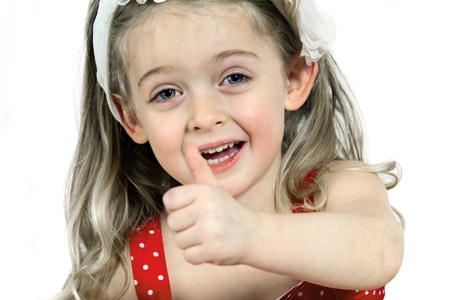 Close-up of a little Girl showing thumbs up, white Background photo