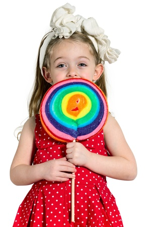 Close-up of a little Girl with a big colorful lollipop, white Background photo
