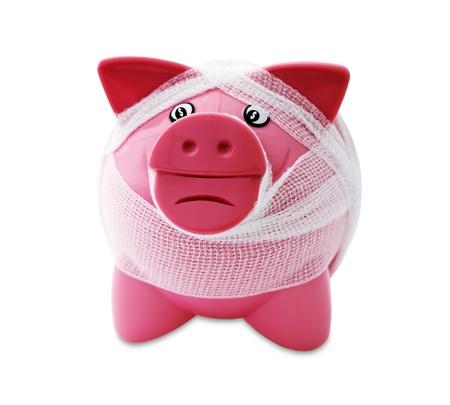 financially: Bandaged piggy Isolated On White