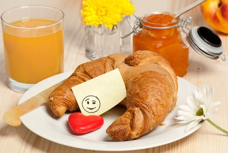 breakfast smiley face: Breakfast with Croissant  juice, jam and Smiley Sticky Note