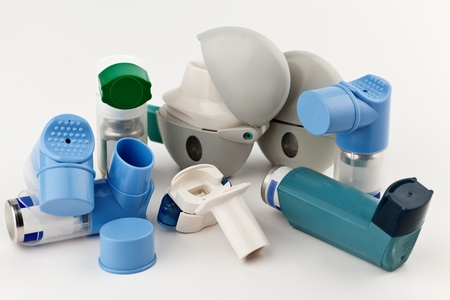 inhaling: Close-up of asthma inhalers on white background  Stock Photo