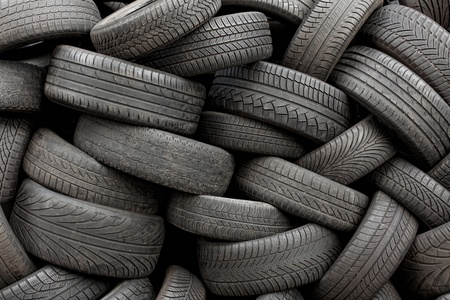 Wall of old car tires background, full frame photo