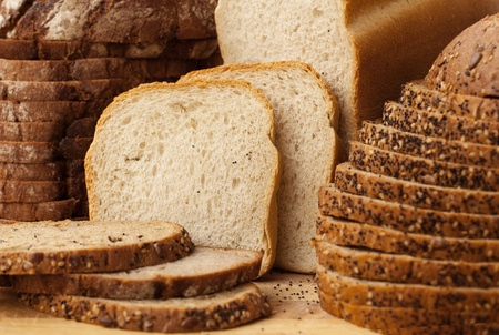 Delicious, fresh Variety of Breads Sliced, Full Frame photo