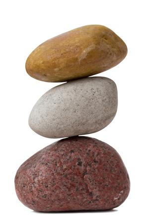 Balancing of pebbles  Isolated on White photo