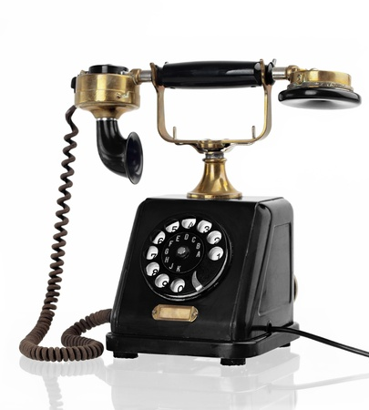 Old-fashioned 1900-1920 Retro-Styled phone,  isolated on white background  photo
