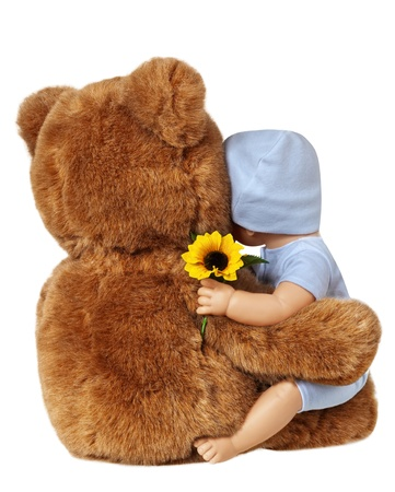 Teddy Bear and Doll Embracing Isolated On White photo