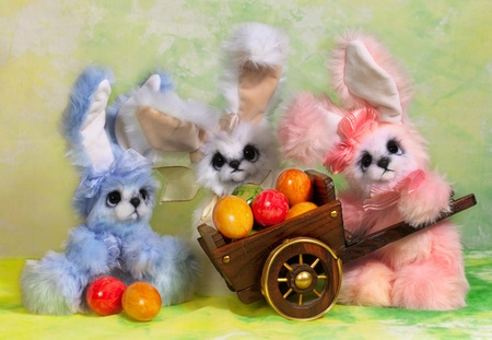 Three Easter bunny rabbit with Easter basket full of decorated Easter eggs  photo