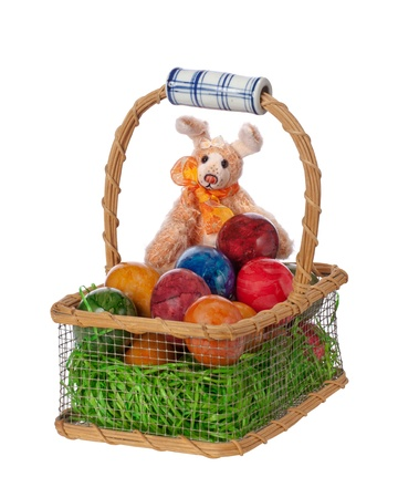 Easter bunny rabbit with Easter basket full of decorated Easter eggs  photo