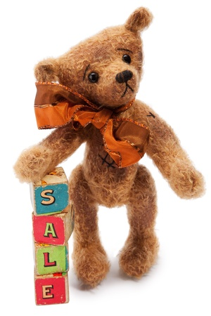 toy blocks: Cute Teddy bear sitting and toy building blocks with Text  SALE , against on white background