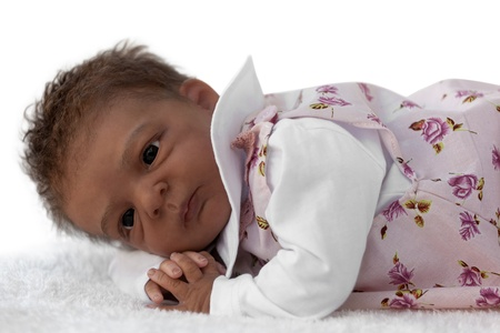 A newborn baby Doll Lying Down, Isolated on White Stock Photo