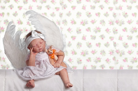 baby doll: Cute baby Doll Angel sitting sleep with Bunny and wings Stock Photo