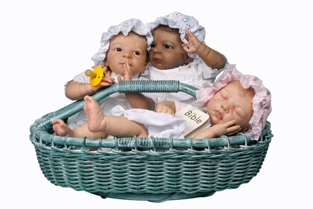 Cute Three Baby with Mop Hat sitting in the Basket, Isolated on white photo