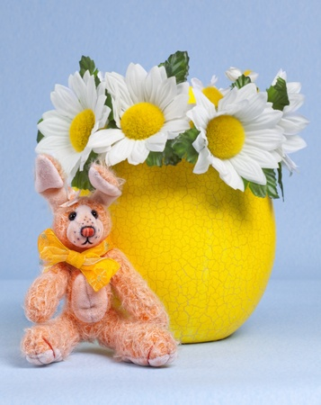 yellow Easter Egg with daisy and Bunny on blue background and light Shadow Stock Photo - 13556348