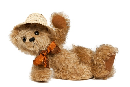 baby bear: Brown Teddy bear with Bow and Summer Hat lying Down,  isolated on white Stock Photo