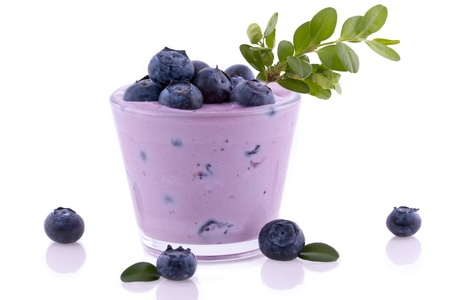 Blueberry smoothie close up  Isolated on white background