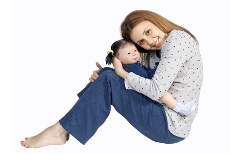 A mother lovingly holding at her Mixed Race baby Doll, isolated on white Background Stock Photo - 14349959