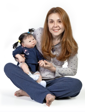 mixed race baby: A mother lovingly holding at her Mixed Race baby Doll, isolated on white Background
