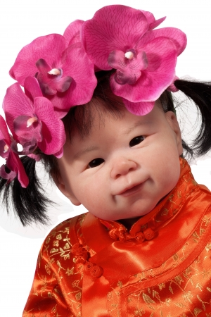 Adorable Asian Baby Doll Smiling whit isolated on white photo