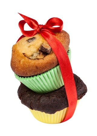 Two Muffins with red Bow isolated on white photo