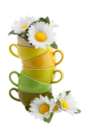 household objects: Stack of Coffee Cups with Daisy Flower isolated on white