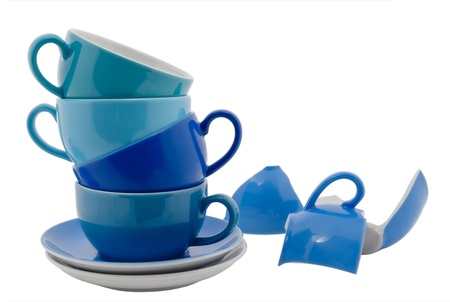 Stack of blue Coffee Cups and one broken cup, isolated on white photo
