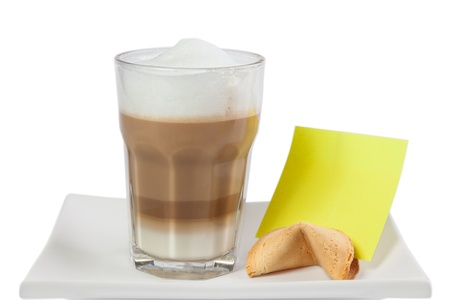 Cafe Latte in a glass with fortune cookie on White Background photo