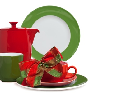 christmas tea: Multi colored Christmas Dishware with Bow on white Background