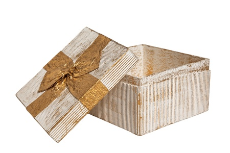 white Vintage box tied with a gold ribbon bow  A gift for Christmas, Birthday, Wedding, or Valentine Stock Photo - 15912778