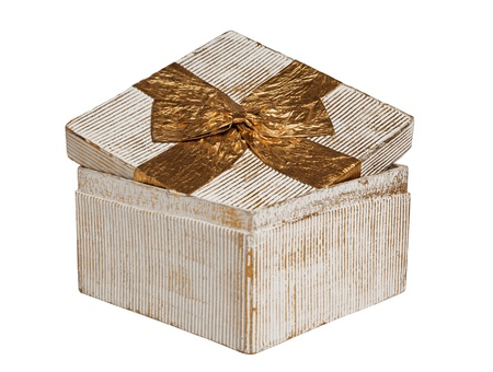 white Vintage box tied with a gold ribbon bow  A gift for Christmas, Birthday, Wedding, or Valentine Stock Photo - 15912779