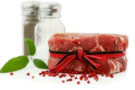 peppercorns: Raw Steak with red peppercorns and Ingredient Isolated on White Stock Photo