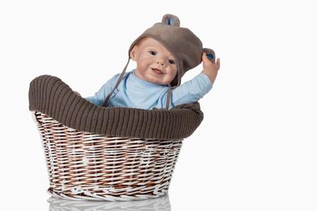 studio photography: Sweet beautiful baby Doll Boy sitting in vintage basket