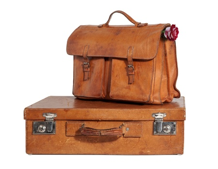 leather briefcase: Set of Well-Traveled Vintage Suitcase and Briefcase isolated on white Stock Photo