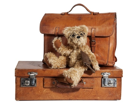 teddy bear: Set of Well-Traveled Vintage Suitcase and Teddy Bear isolated on white