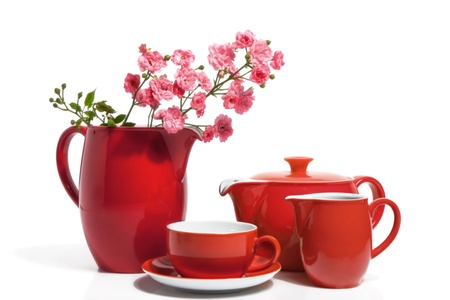 Summer Red Dishware with Pink Roses, isolated on white  photo