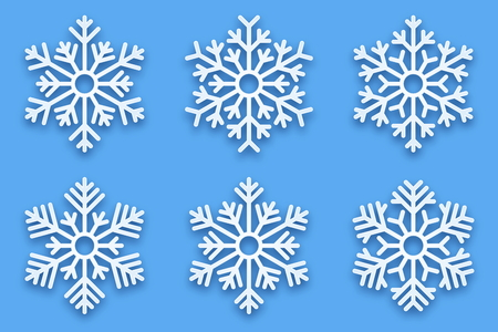 3D Vector Papercut Decorative Handmade Snowflakes Set with Soft Drop Shadow Isolated on Light Blue Background. Merry Christmas and Happy New Year Decoration Design Element
