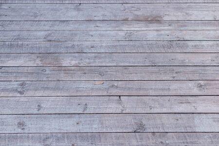 graue alte horizontale Bretter Rustikaler Hintergrund aus verwittertem Holz mit Nägeln