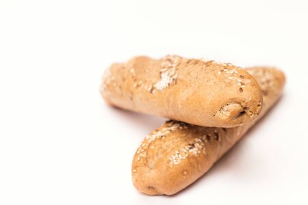 two French baguette with sesame seeds on a white background Reklamní fotografie