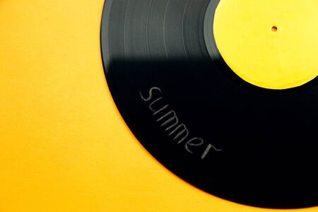 bright vinyl record of modern fashionable music with scratched inscription summer close-up on a yellow background. summer music concept. place for text Standard-Bild - 137884681