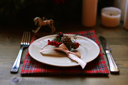 grunge silverware: Christmas place setting and decorations on wooden table