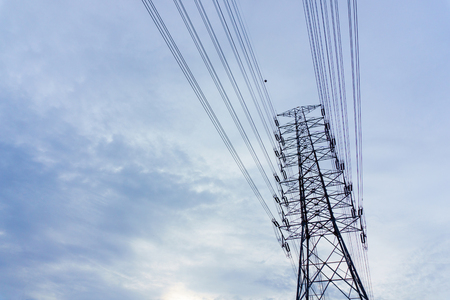 high tech: electricity transmission pylon with blue sky and cloud when sunset.