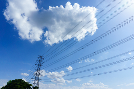 high tech: electricity transmission pylon with blue sky and cloud when sunny
