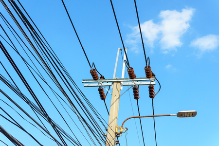 high tech: 230 Kv low voltage pole with electricity transmission line with blue sky and cloud Stock Photo