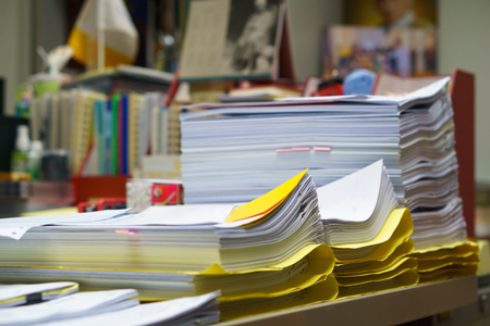 stack of organized but unfinished business document on the desk. busy business or busy job concept.