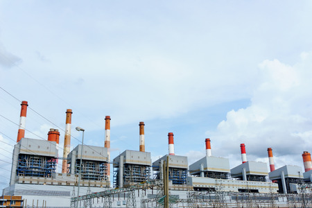 high tech: group of power plant smoke stack tower with  blue sky and cloudy