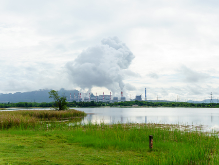 oil and gas industry: panorama view of power plant generating electricity in the morning and release steam from the stack. Stock Photo