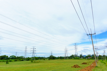 high tech: high voltage electricity pylon with blue sky and cloud Stock Photo