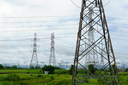 500 KV transmission line in maemoh lampang thailand. electricity transmission pylon with blue sky and cloud.