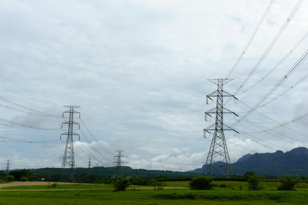 high tech: 500 KV transmission line in maemoh lampang thailand. electricity transmission pylon with blue sky and cloud.